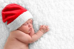 新出生的圣诞老人婴孩 库存照片