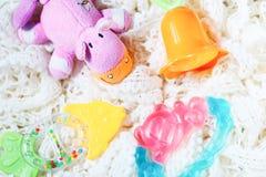 新出生的套teether和吵闹声玩具  免版税库存图片