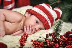 新出生的婴孩圣诞老人 图库摄影