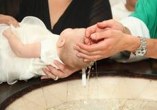新出生的婴孩洗礼 库存图片