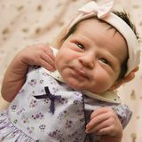 新出生预警的婴孩 免版税图库摄影