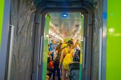 新加坡- 2018年2月01日:在的红色单轨铁路车里面的未认出的人在圣淘沙海岛 圣淘沙海岛是普遍的 库存图片