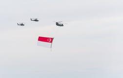 新加坡2015年7月, 18 :在天空的直升机飞行第五十安的 图库摄影
