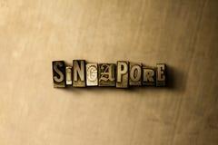 新加坡-脏的葡萄酒在金属背景的被排版的词特写镜头  免版税库存图片