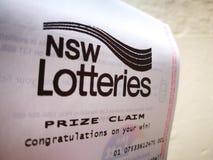 新南威尔斯抽奖得奖的要求纸说您的胜利的祝贺在白皮书 免版税库存照片