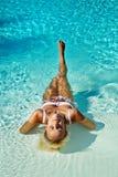 新可爱的妇女在水中 图库摄影