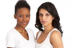新可爱的工作室二的妇女 免版税库存照片