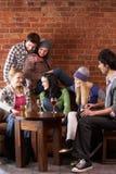 新咖啡馆的朋友 免版税库存图片