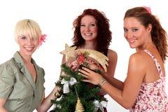 新圣诞节愉快的星形三的妇女 库存图片