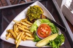 新墨西哥绿色辣椒乳酪汉堡 图库摄影