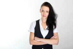 新女商人纵向有头发的在一个端在工作室 免版税库存照片