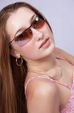 新女孩的太阳镜 免版税库存图片