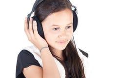 新女孩的耳机 免版税库存照片