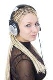 新女孩的耳机 免版税库存图片
