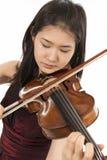 新女性小提琴球员 免版税库存图片