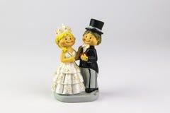 新娘和新郎的图在白色背景 免版税库存图片