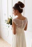 新娘的画象一套婚礼礼服的与花束 库存照片