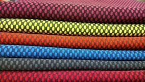 新工业黄色,橙色,灰色,蓝色和紫罗兰滚动背景 概念:材料,织品,制造,服装工厂,新 免版税库存图片