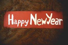 新年在一块木减速火箭的牌的` s标志 库存照片