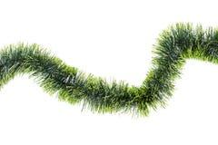 新年在白色背景的绿色闪亮金属片 免版税库存图片