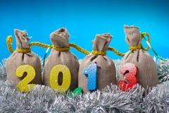 新年度概念。与2013年的四个袋子 免版税库存图片