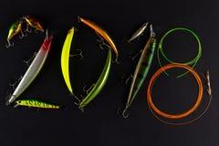 新年快乐与渔诱剂和钓丝的2018构成 库存图片