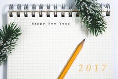 新年快乐概念、笔记本和黄色铅笔 库存图片