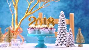 新年快乐2018块杯形蛋糕 免版税库存照片