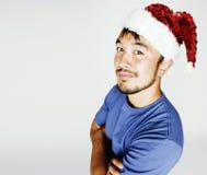 新年红色帽子微笑的Funy异乎寻常的亚洲人圣诞老人 免版税图库摄影