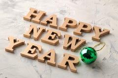 新年2019年 节假日 构成与词新年快乐 在一个轻的背景 免版税库存照片