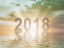 新年2018数字文本日落迷离背景 免版税图库摄影