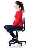 新愉快的妇女坐轮椅 免版税库存照片