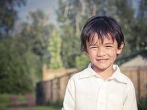 新男孩微笑 免版税图库摄影