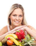 新白肤金发的妇女和新鲜水果的纵向 免版税库存图片