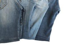 新的四件牛仔裤。 库存图片