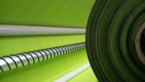 新的工业石灰卷,绿色背景 概念:材料,织品,制造,服装工厂,织品新的样品  库存图片