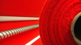 新的工业红色卷,红色背景 概念:材料,织品,制造,服装工厂,织品新的样品  库存照片