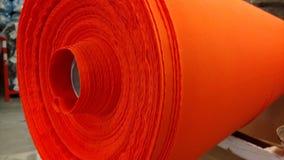 新的工业红色卷,红色背景 概念:材料,织品,制造,服装工厂,织品新的样品  免版税库存图片