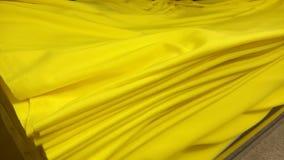 新的工业黄色卷,黄色背景 概念:材料,织品,制造,服装工厂,织品新的样品  库存照片