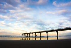 新的布赖顿码头日落,克赖斯特切奇,新西兰 免版税库存照片