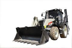 新的拖拉机,建筑机械 在隔离的Windows 免版税库存照片