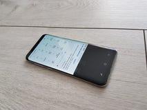 新的旗舰编辑-弯曲的屏幕电话次要菜单 库存图片