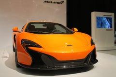 新的橙色英国超级汽车 免版税图库摄影