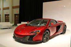 新的红色英国超级汽车 免版税库存图片