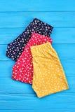 新的被折叠的女婴裤子 库存照片