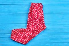 新的被折叠的色的女婴裤子 免版税库存图片
