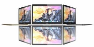 新的金子、银和空间灰色MacBook空气 免版税库存照片
