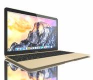新的金子MacBook空气 免版税库存图片