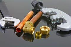 新的铜管道工程管组准备好建筑 免版税库存照片