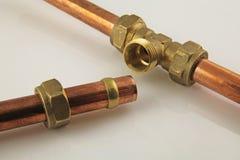 新的铜管道工程管组 库存照片